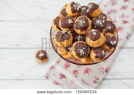 eclairs on wood background