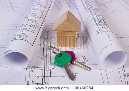 House Of Wooden Blocks, Rolls Of Diagrams And Keys On Construction Drawing Of House