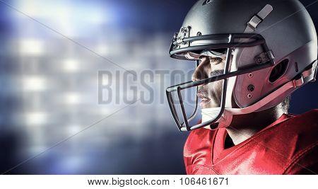 Side view of sportsman wearing helmet against white lights glowing