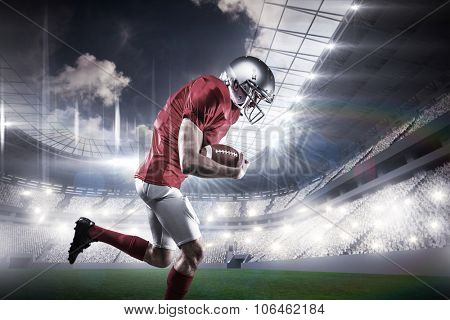American football player holding ball while running against rugby stadium
