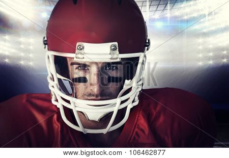 Portrait of a serious rugby player against american football arena