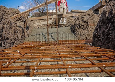 Concrete Is Spreading In Foundation Over Reinforcing Steel Bars.