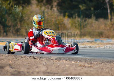Karting - driver in helmet on kart circuit