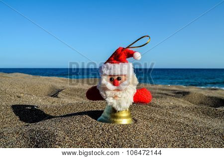 Santa Claus Toy on the Sand Beach