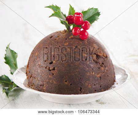 Christmas Pudding With Holly On White Plate.