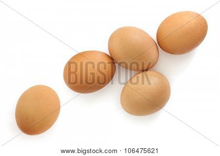 Brown eggs isolated on white background.  Overhead view.