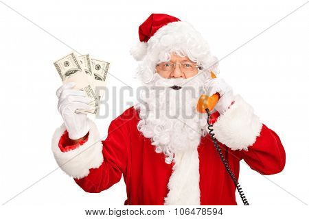 Santa Claus talking on the phone and holding three stacks of money isolated on white background