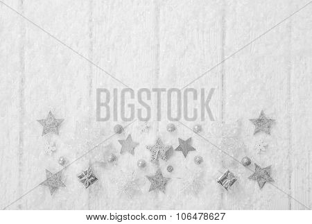White, grey and silver christmas background with wood, snow and stars for decoration in shabby chic style.