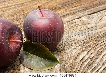 Stark apples on wooden background