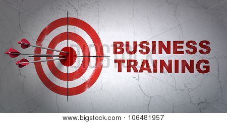 Education concept: target and Business Training on wall background