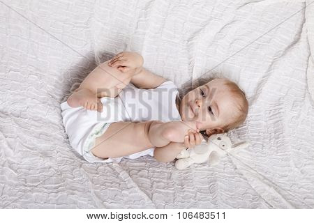 Innocent Baby Girl Playing In The Bed