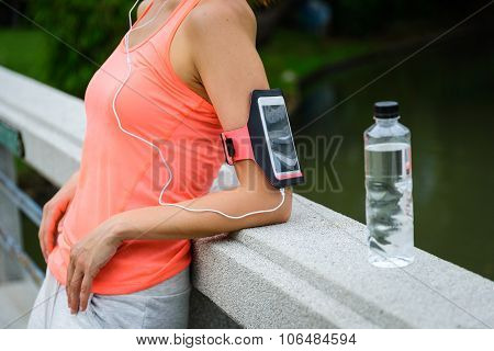 Fitness Woman With Smartphone Armband Ready For Workout