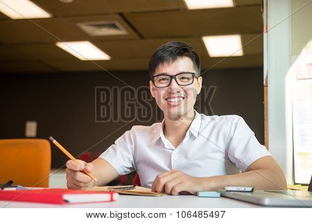 Young male student studies for the examination in university