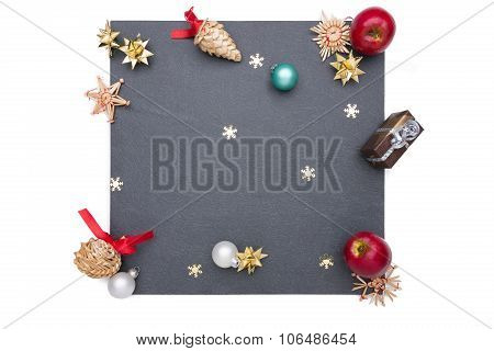 Plate Of Slate With Christmas Decoration Around It