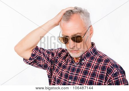 Gray Aged Man With Sunglasses Touching His  Hair