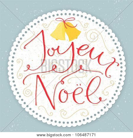 Joyeux Noel - french phrase means Merry Christmas. Modern calligraphy with swirls at round paper fra