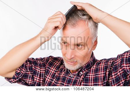 Handsome Gray Aged Man Combing Hair