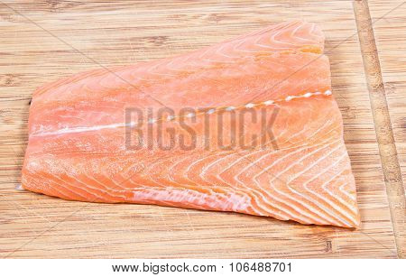 Fresh Salmon Fillet On A Wooden Background. Sources Of Omega 3 Fatty Acids.