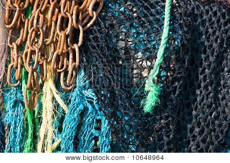 Fishing Nets And Rusty Chain