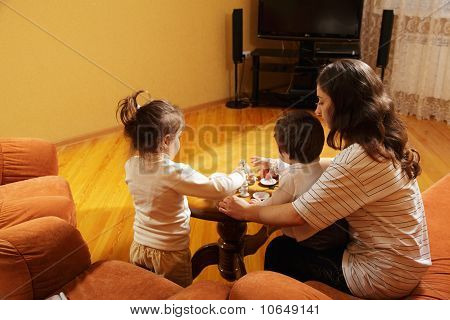 Mother Playing With Daughters At Home