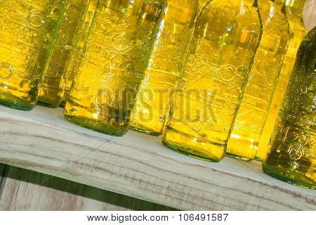 Yellow Drink Bottles On Wooden Shelf
