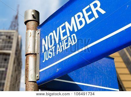 November Just Ahead blue road sign