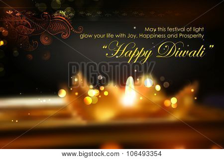 illustration of golden lotus shaped diya on abstract Diwali background