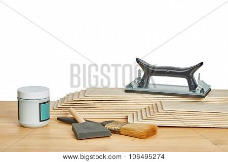 Sandpaper Holder, Stack Of Veneers And Paint Brushes
