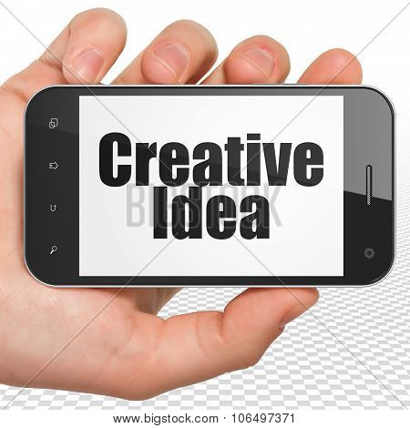 Business concept: Hand Holding Smartphone with Creative Idea on display