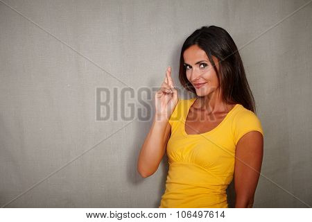 Brunette Female Expecting While Crossing Fingers