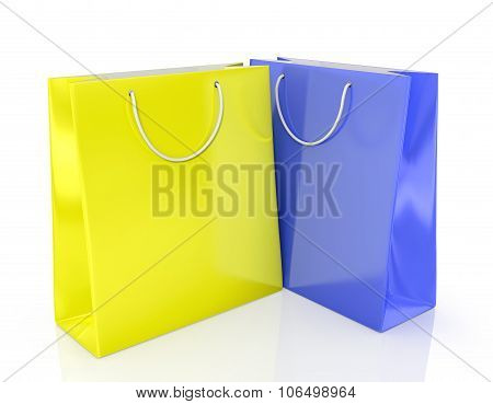 Two Paper Shopping Bags Yellow And Blue On A White Background.