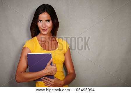 Confident Young Woman Carrying A Tablet