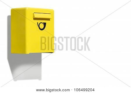 Yellow letterbox on white wall