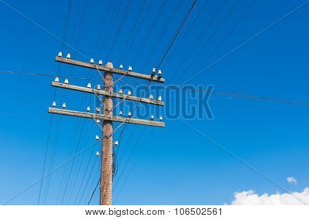 wooden pole for an electricity in rural Ukrainian area