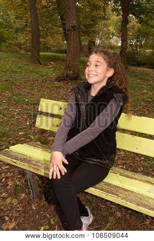 Portrait Of A Beautiful Ten Years Old Little Girl In Autumn Park