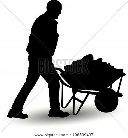 worker pushing loaded cart