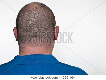 The Back Of A White Male Head On White