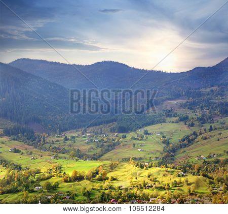 Village on bright green meadows