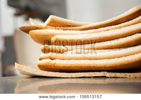 Closeup of stacked bread waste in bakery