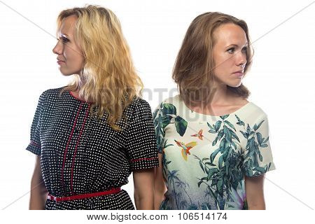 Two blond women looking at different sides