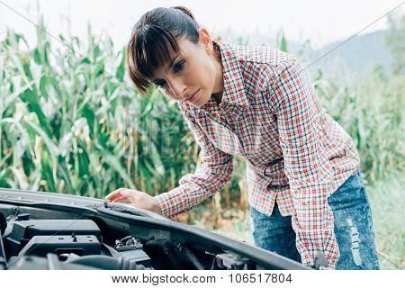 Woman Trying To Repair Her Broken Car