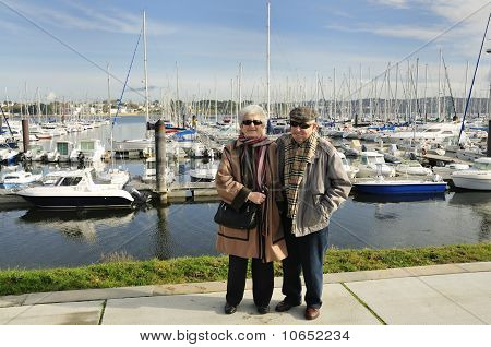 Senior Couple At Yacht Harbor