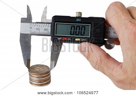 Stack Of Coins Measured With A Caliper In Mans Hand