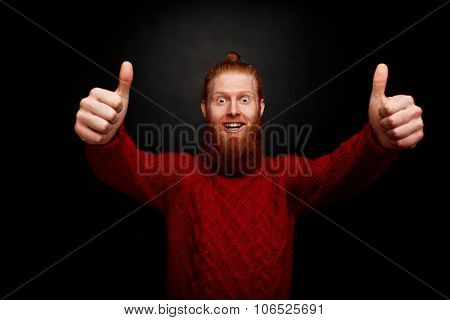 Smiling Bearded Man Showing Thumb-ups. Happy Man In Red Knitted Sweater Satisfying His Lifestyle On