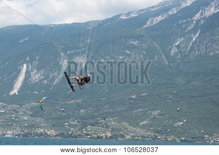 Kite Surfer In The Air At Lake Garda, Italy