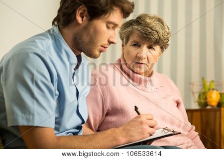 Male Doctor And Elder Woman