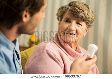 Doctor Prescribing Senior Woman Medicament