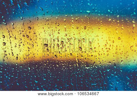 Drops Of Rain On Glass On Glass Background