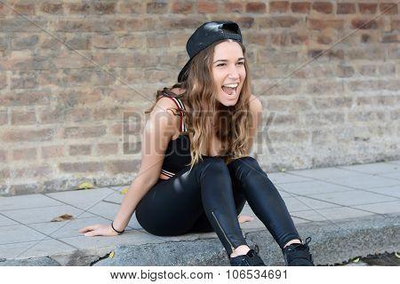 Hispanic Woman Against A Brick Wall.