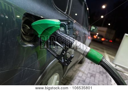 Filling Modern Car With Petrol At An Gas Station